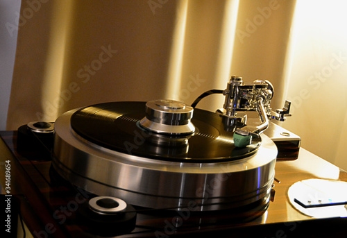 Audiophile turntable with vinyl record. Canvas Print