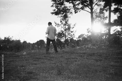 Cuadros en Lienzo Full Length Rear View Of Man Urinating In Field