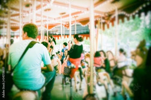 Rear View Of People Enjoying Merry-go-round Canvas-taulu