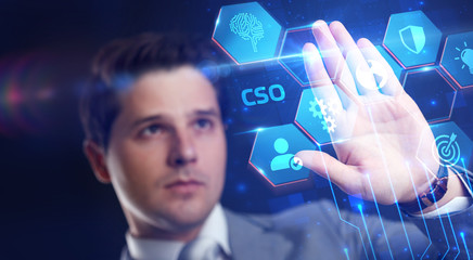 Business, Technology, Internet and network concept. Young businessman working in virtual reality glasses sees the inscription: CSO