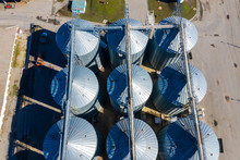 Set Of Storage Tanks Raw Material Agricultural Crops Feed Mills. Aerial Vew From Drone