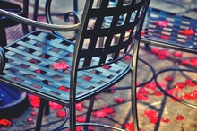 Empty Chairs At Sidewalk Cafe