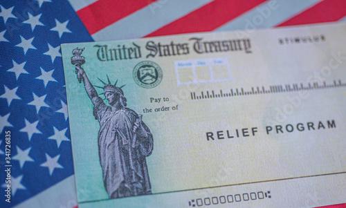 Fototapeta  COVID-19 economic Stimulus check on blurred background. Relief program concept. obraz
