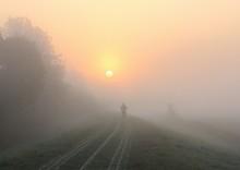 Man Running On Path At Sunrise