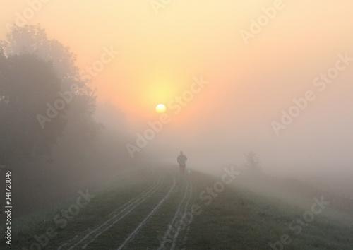 Tela Man Running On Path At Sunrise