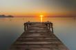 Leinwandbild Motiv Pier Over Sea Against Sky During Sunset
