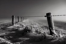 Close-up Of Fence On Snow Cove...