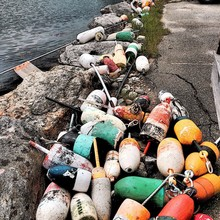 High Angle View Of Old Buoys On Seaside
