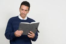 Portrait Of Mature Handsome Man Reading Book