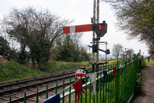 An Old Steam Train Line With Traditional Railway Signal Next To The Railway Tracks