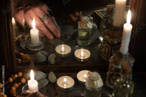 Fotografering Hand of fortuneteller with a magic symbol during spiritual session