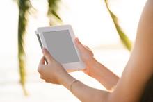 Woman Holding E-reader Outdoor...