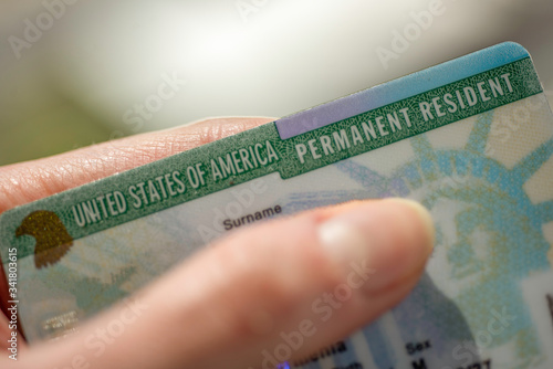 Valokuvatapetti Close up view of Permanent resident card (Green) card of USA on blurred background