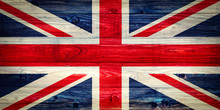 An Old Union Jack On Wooden Su...