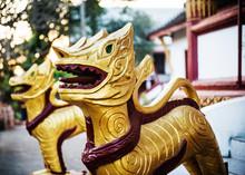 Golden Statues Outside A Templ...