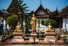 Gold Buddhist Statues Outside ...