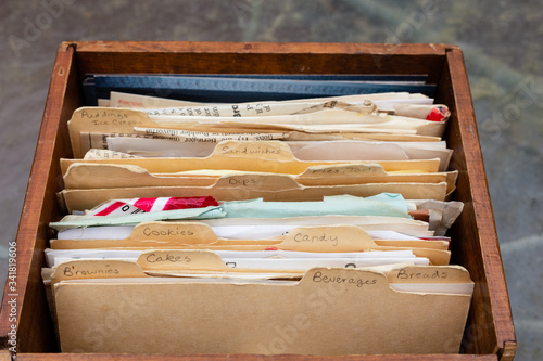Photo Old handwritten recipes on 3x5 index cards with tabs in wooden box