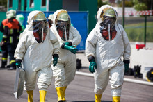 Three Men In Protective Gear D...