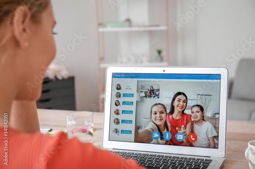 Fototapeta Young woman video chatting with family at home obraz na płótnie
