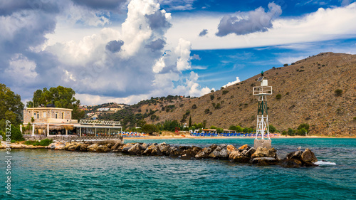 View of sunbeds awaiting tourists at the Greek island resort of Georgioupolis on Crete north coast Canvas Print