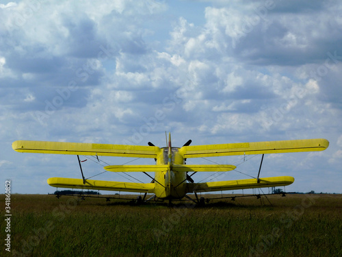 old yellow double wing or biplane Wallpaper Mural