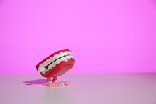 Classic Chattering Teeth Wind-up Toy On A Modern Pink Background With Copy Space.