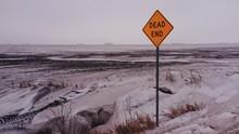 Dead End Sign Post On Landscape