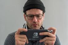 Millennial Man Playing Video G...