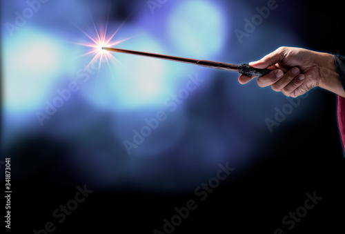 Magic wand on mysterious background, Miracle magical stick Wizard tool on black