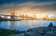 Famous Skyline of downtown New York, Brooklyn Bridge and Manhattan at the early morning sun light , New York City USA .