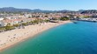 Aerial shot of a french city by the sea on a summer sunny day. View of the sea, beach, coastline. Saint Raphael, France in 4K 60fps