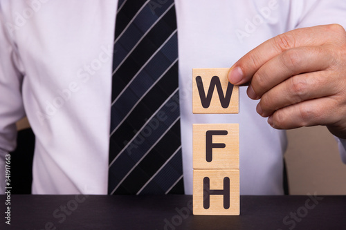 Photo Business Acronym WFH as Work From Home. Conceptual image.