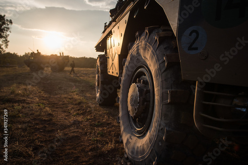 Carta da parati vehicles stoped with a sunset in the background during the preparation in the Ca