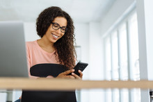 Young Woman Checking Her Messages At Work