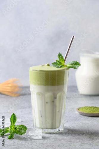 Canvas Print Dalgona Matcha latte tea with milk and whipped tea garnish mint