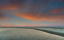 A Shallow Tidal Pool At Sunset...