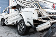 White car completely destroyed in accident. Scrapyard car