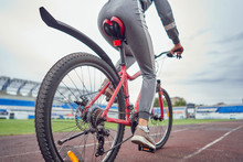 Cyclist Woman Training On The Track. View From Below.