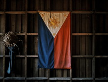 Philippines Flag Hanging From Wooden Wall