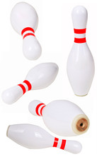 Bowling Pins Scattered On A Wh...