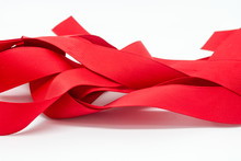 Close-up Of Red Ribbon Against White Background