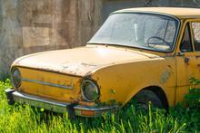 Old Rusty Yellow Car