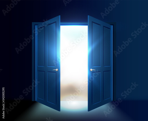 Photo Ajar double door with light and rays of the sun coming out of the gap