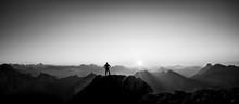 Man Reaching Summit Enjoying F...