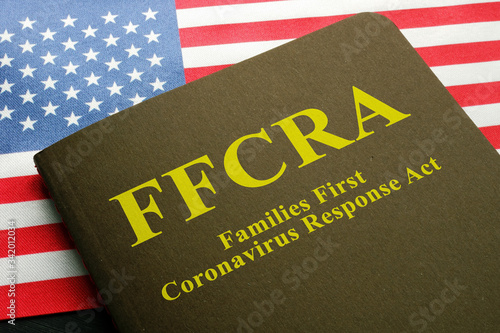 USA flag and families first coronavirus response act FFCRA law. Canvas Print