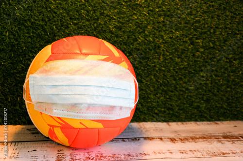 Stampa su Tela no more games because coronavirus volleyball ball in the medical mask