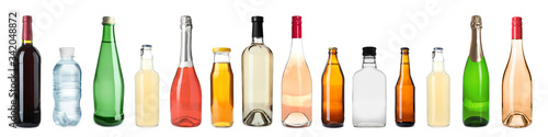 Set of bottles with different drinks on white background Canvas Print
