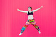 Leinwanddruck Bild - Isolated millennial woman jumping at pink background with horizontal copyspace. Lgbt community in teen people. Gay pride and lesbian lifestyle for women. Strong feminist woman as symbol of progress.