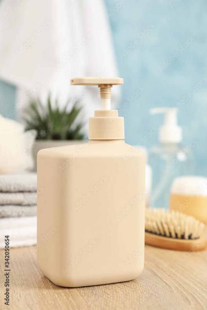 Bottle for liquid soap on wooden table. Personal hygiene concept - obrazy, fototapety, plakaty