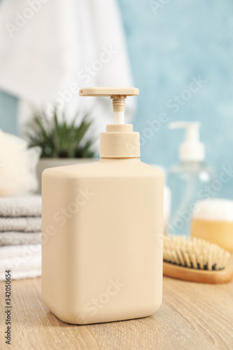 Fototapeta Bottle for liquid soap on wooden table. Personal hygiene concept obraz na płótnie